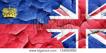 Liechtenstein flag with Great Britain flag on a grunge cracked w