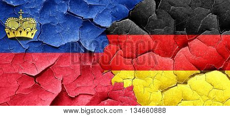 Liechtenstein flag with Germany flag on a grunge cracked wall