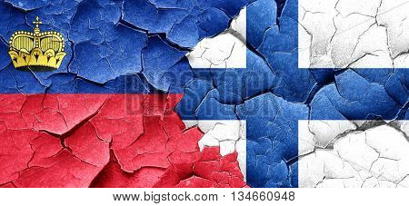 Liechtenstein flag with Finland flag on a grunge cracked wall
