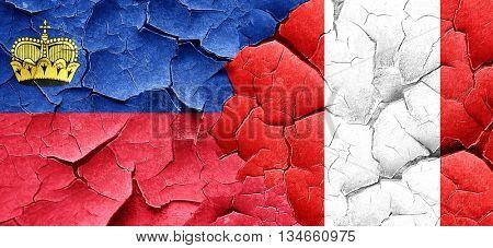 Liechtenstein flag with Peru flag on a grunge cracked wall