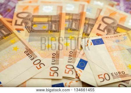 many fifty euro notes lies on table