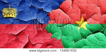 Liechtenstein flag with Burkina Faso flag on a grunge cracked wa