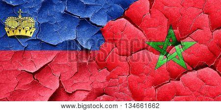 Liechtenstein flag with Morocco flag on a grunge cracked wall