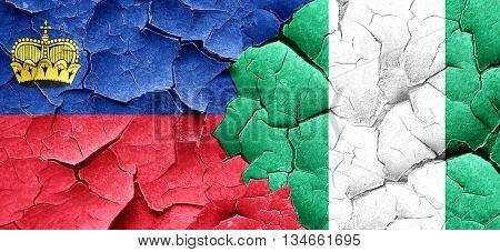 Liechtenstein flag with Nigeria flag on a grunge cracked wall