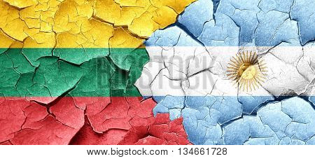 Lithuania flag with Argentine flag on a grunge cracked wall