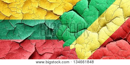 Lithuania flag with congo flag on a grunge cracked wall