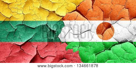 Lithuania flag with Niger flag on a grunge cracked wall