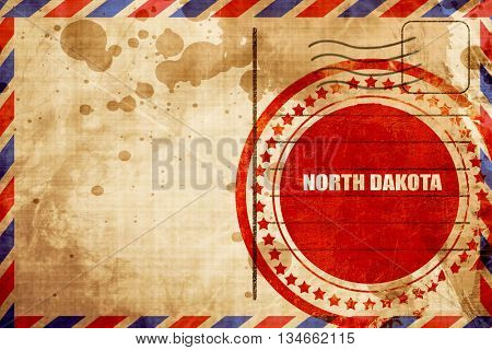 north dakota, red grunge stamp on an airmail background