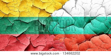Lithuania flag with Bulgaria flag on a grunge cracked wall