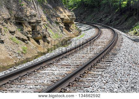 Railroad track curve around a bend in rural West Virginia.