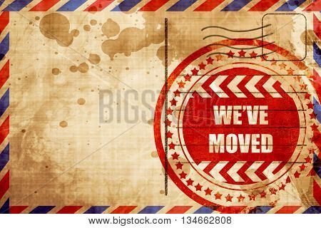 We've moved sign, red grunge stamp on an airmail background