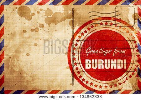 Greetings from burundi, red grunge stamp on an airmail backgroun