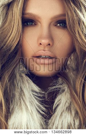 Beauty Fashion Model Girl In A Fur Hat. Winter Woman Portrait.