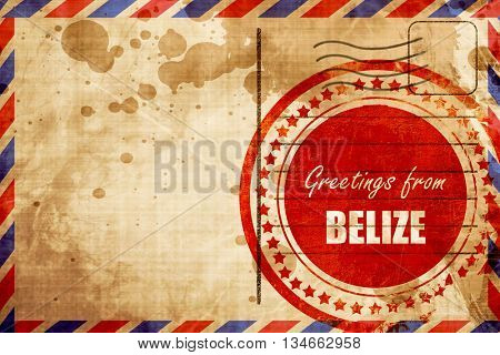 Greetings from belize, red grunge stamp on an airmail background
