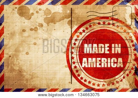 Made in america, red grunge stamp on an airmail background