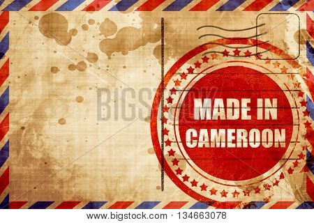 Made in cameroon, red grunge stamp on an airmail background