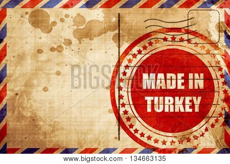 Made in turkey, red grunge stamp on an airmail background