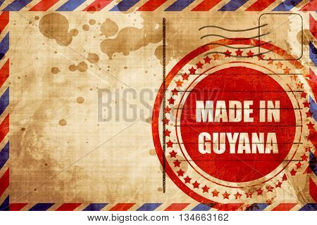 Made in guyana, red grunge stamp on an airmail background