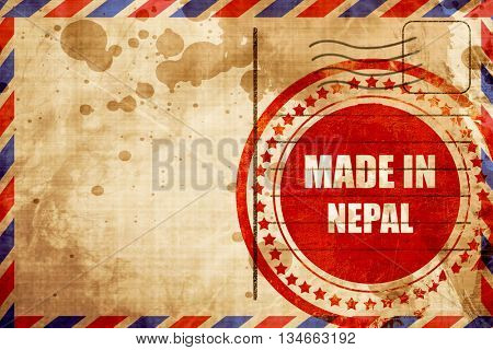 Made in nepal, red grunge stamp on an airmail background