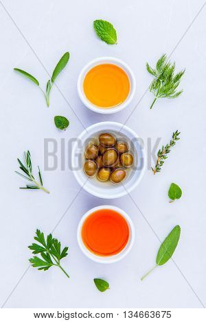 Different Sorts Of Cooking Oil,olive Oil Flavored And Sesame Oil With Spices  Set Up With Marble Bac