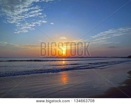 Beautiful sunset sky with reflection at Weligama beach, Sri lanka