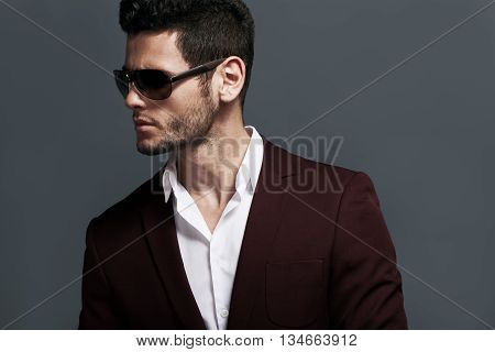 Elegant Young Handsome Man Wearing Glasses And Wathers.