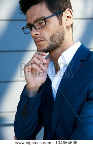 Elegant Young Handsome Man Wearing Glasses And Watchers. Portrait In The Sun.