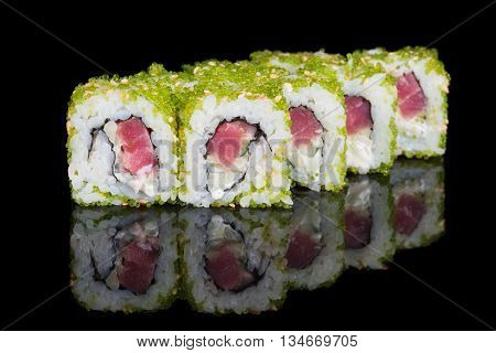Sushi rolls with tuna cucumber and flying fish roe on black background
