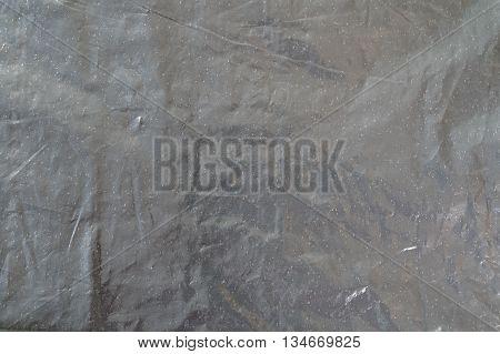 folded shiny dark gray foil bag texture