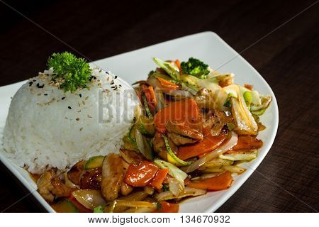Chicken And Vegetables Served With Stemmed Rice