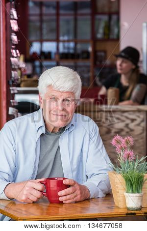 Mature Man In Coffee House
