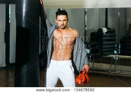 Man In Boxing Gloves With Punching Bag