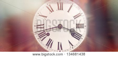 Single round antique wind up clock face with Roman numerals and red blurry edges
