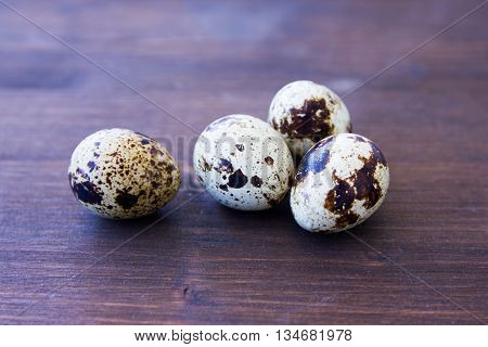 Some quail eggs on a wooden table