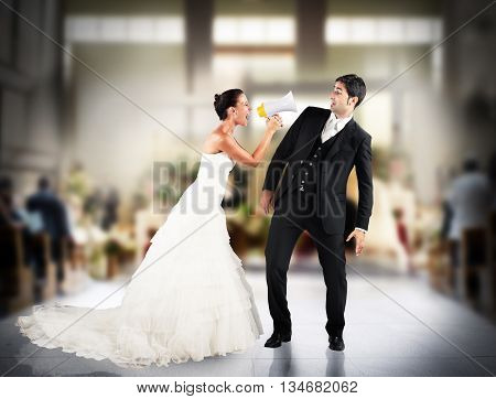 Angry wife screaming with megaphone to husband
