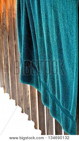 Towel hanging on patio deck in the winter snow outdoors.