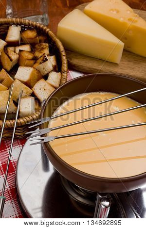 Set of products and utensils for cooking cheese fondue