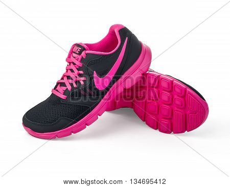 Chisinau Moldova- May 27 2015: Nike lady's - women's running shoes - sneakers - trainers in gray and pink showing the Nike swoosh logo and sole - illustrative editorial