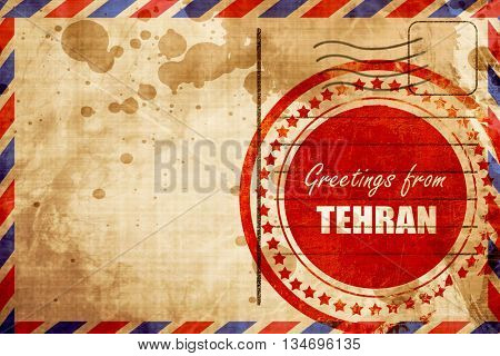 Greetings from tehran, red grunge stamp on an airmail background