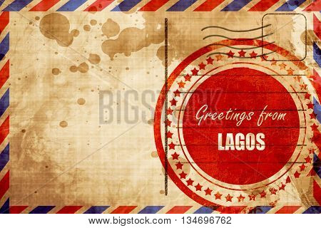Greetings from lagos, red grunge stamp on an airmail background
