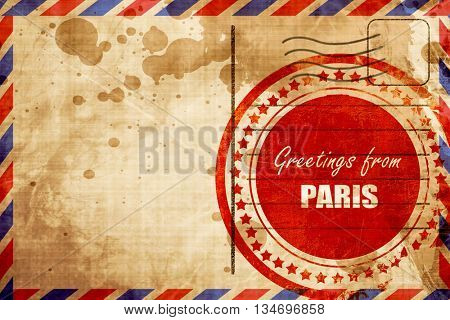 Greetings from paris, red grunge stamp on an airmail background