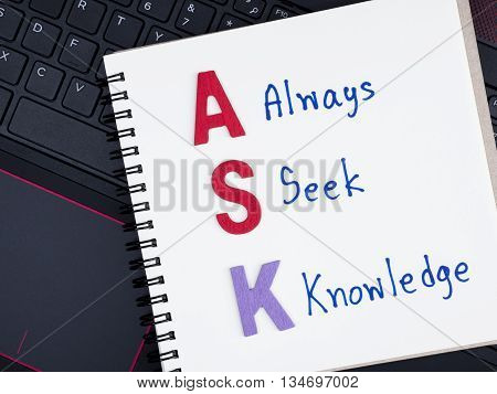 Word spell ASK and handwriting word Always Seek Knowledge on notebook with laptop keyboard