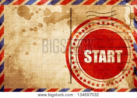 start, red grunge stamp on an airmail background