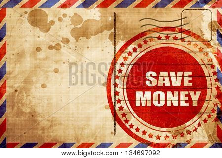 save money, red grunge stamp on an airmail background