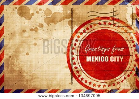 Greetings from mexico city, red grunge stamp on an airmail backg