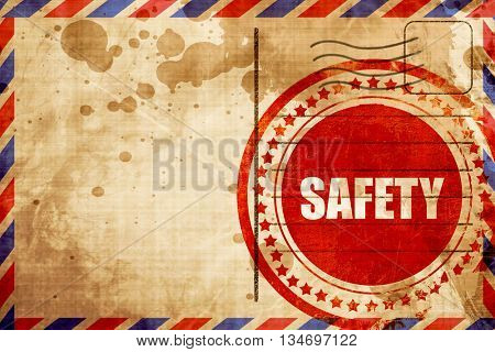 safety, red grunge stamp on an airmail background