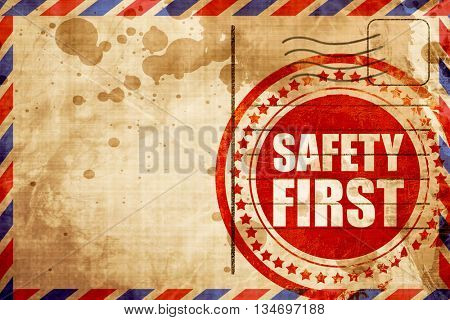 safety first, red grunge stamp on an airmail background
