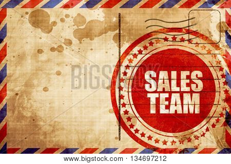 sales team, red grunge stamp on an airmail background