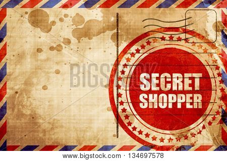 secret shopper, red grunge stamp on an airmail background