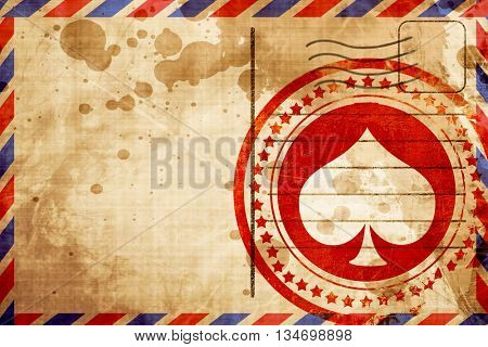 Spade card background, red grunge stamp on an airmail background